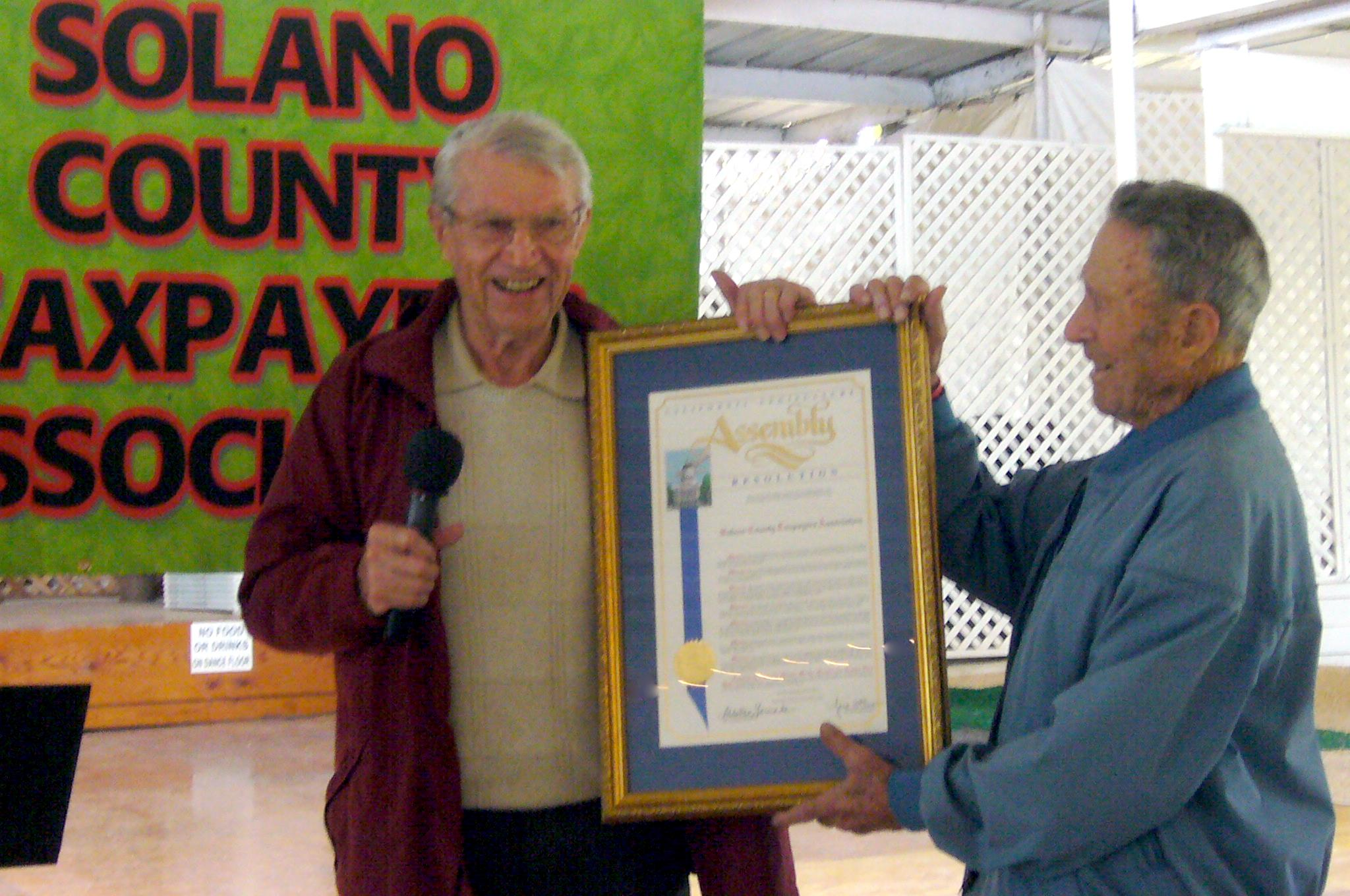 Earl Von Kaenel and Earl Campini proudly displaying the California Legislature Resolution presented to SCTA for their 50th anniversary. October 17, 2010.